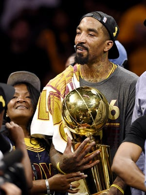 Jun 19, 2016; Oakland, CA, USA; Cleveland Cavaliers guard J.R. Smith (5) with the Larry O'Brien Championship Trophy after beating the Golden State Warriors in game seven of the NBA Finals at Oracle Arena