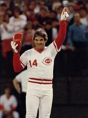 FILE--Cincinnati Reds Pete Rose signals he's #1 after connecting for his 4192nd career base hit to break Ty Cobb's all-time record Sept. 11 1985 in Cincinnati. Exactly 10 years after Rose agreed to his lifetime ban from baseball commissioner Bud Selig said the sport's career hits leader would be invited to the World Series if he's elected to the All-Century team. (AP Photo/Bill Waugh)