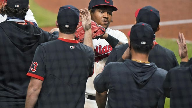 Cleveland Indians' Jose Ramirez is congratulated by teammates after the Indians defeated the Chicago White Sox 5-4 in a baseball game, Thursday, Sept. 24, 2020, in Cleveland.