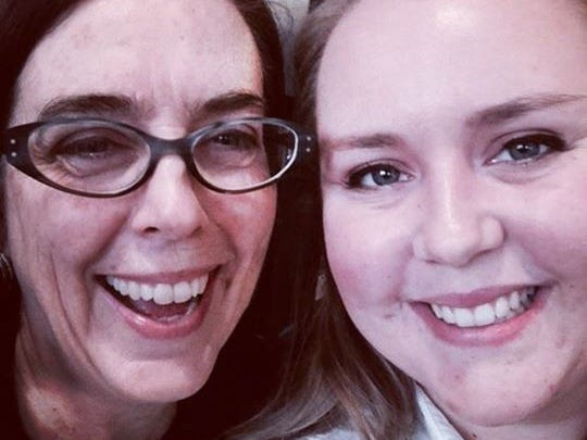 Oregon Gov. Kate Brown poses for a selfie with Republican staffer Tayleranne Gillespie on Thursday.