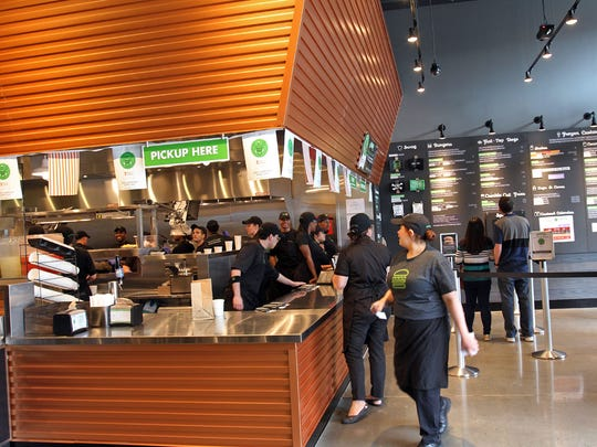 Shake Shack workers practice on Friends and Family day on Thursday, prior to Friday's opening of the new business at the Village at Bridgewater Commons.