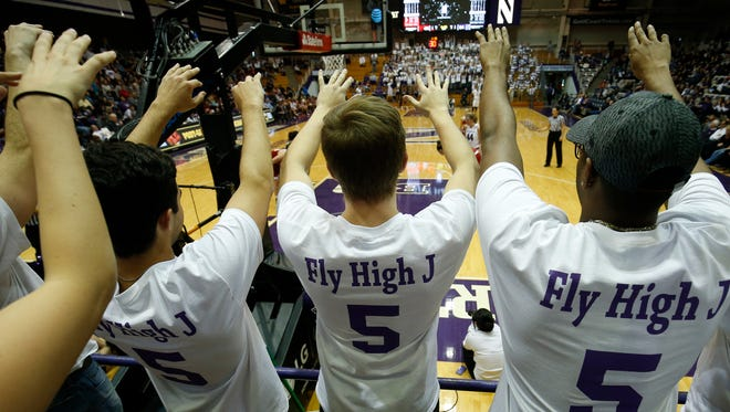 Supporters of Northwestern women's basketball player Jordan Hankins cheer as they wear T-shirts made in her memory at the Welsh Ryan Arena in Evanston, Ill., Saturday, Jan. 14, 2017. Hankins, a sophomore from Indianapolis, was found dead in her room earlier in the week.  (Jim Young/Chicago Tribune via AP)