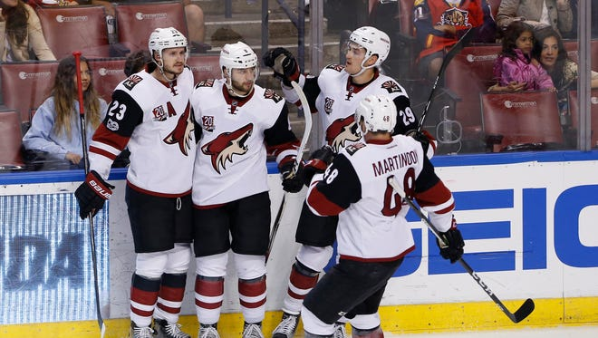 Mar 23, 2017: Arizona Coyotes right wing Tobias Rieder (8) celebrates his goal against the Florida Panthers with defenseman Oliver Ekman-Larsson (23) left wing Jordan Martinook (48) and left wing Brendan Perlini (29) in the first period at BB&T Center.