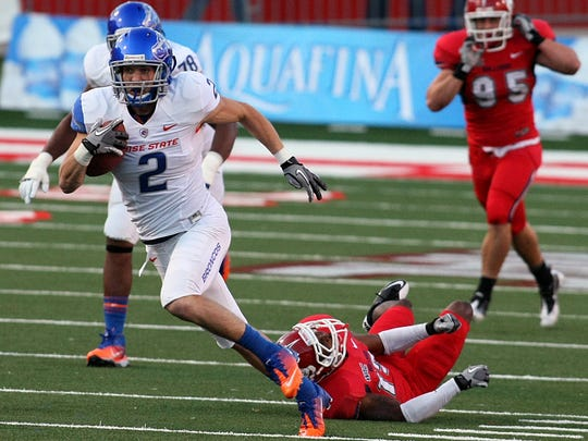 Helena native Matt Miller of Boise State heads for the end zone.