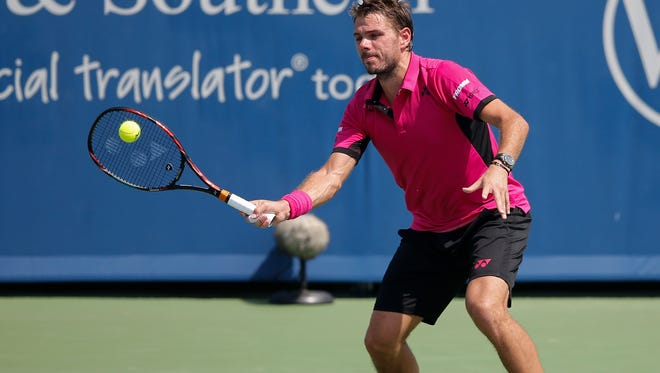 Stan Wawrinka, of Switzerland, returns a shot to Grigor Dimitrov, of Bulgaria, during their quarterfinal match at the Western & Southern tennis tournament, Thursday, Aug. 18, 2016, at Lindner Family Tennis Center in Mason, Ohio.