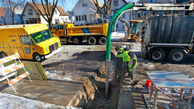 Milwaukee Public Works Department crews repair a break in the city-owned section of a lead service lateral between the water main and a private property boundary in the 2100 block of S. 14th St. in this file photo.
