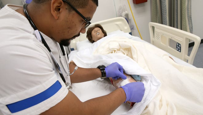 David Walker works on a simulated wound at the Isabella Graham Hart School of  Practical Nursing at Rochester Regional Health. Walker wants to be a flight nurse in the Air Force, and is motivated by the death of his brother, Daniel Rivera, in 2009 in Iraq.
