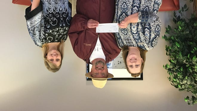 Bank of the Ozark recently donated $500 to Alpha House. Shown are Myrna Killian, branch manager, from left, Bill Webster, Alpha House director, and Laura Saeler, head teller. Alpha House is a place for homeless men to call home while they get back on their feet. Bank of the Ozarks encourages the Twin Lakes Area to contact Bill Webster about making a donation to the Alpha House so they can continue to assist men as they reconnect with society.