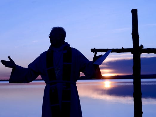 Rev. Mark Twietmeyer of Trinity Lutheran Church delivers an Easter sermon at the Boulder Reservoir on April 20 in Boulder, Colo.