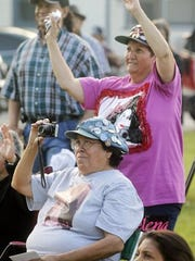 Michael Zamora/Caller-Times Maria Reyes Matson of Corpus Christi (above) and Maria Anita Monsivaiz of San Antonio watch performances Thursday during the annual Selena tribute at Molina Veterans Park.