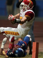 Palm Desert's Simon Gaete carries the ball to the one