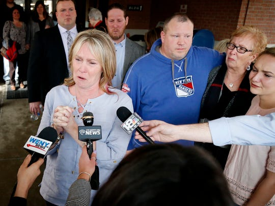 With family behind her, Kelley Stage Clayton's sister, Kim Bourgeois, tearfully addresses the media after the guilty verdict came down on Thomas Clayton, who was accused of hiring Michael Beard to kill Kelley. She was found bludgeoned in her Caton home on Sept. 29, 2015.