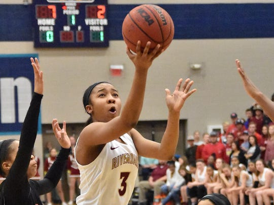 Riverdale's Anastasia Hayes (3) drives to the basket against Stewarts Creek in the Region 4-AAA championship.