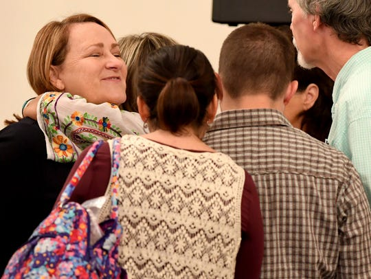 Karen Bobo reaches out to hug State prosecutor Jennifer