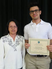 W+H presented Stan with a $100 scholarship award and a certificate in recognition of this accomplishment. Stan is pictured with Hua Liu, Upper School Mandarin instructor.
