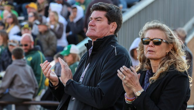Mountain West commissioner Craig Thompson and his wife, Carla, cheer on Wyoming's football team during a Sept. 16 football game against Oregon at War Memorial Stadium in Laramie, Wyo. Thompson said the athletic directors of MW schools want to maintain the flexibility in their conference schedules that allows them to play as many non-conference games against marquee opponents like Oregon as they each want.