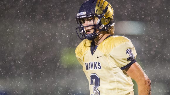 Decatur Central High School senior Tommy Stevens (3) heads to the sidelines during a break in the second half of action. Decatur Central hosted Greenwood High School in varsity football action, Friday, October 3, 2014. Decatur Central defeated Greenwood 34-0.
