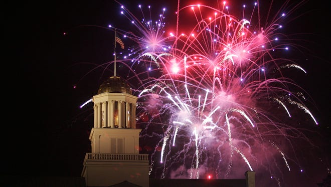 Fireworks are seen by the dome of the Old Capitol building on the University of Iowa Pentacrest during Iowa City's Independence Day celebration on Friday night, July 4, 2008.