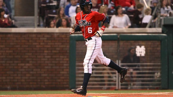 Shortstop Errol Robinson scores a run in the first game of the series between Ole Miss and Mississippi State.