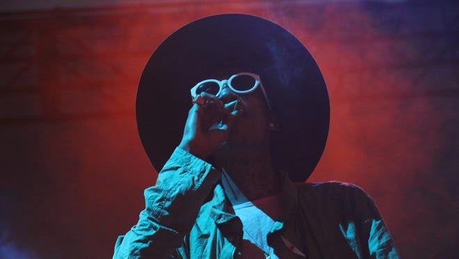Wiz Khalifa performs at the Bonnaroo Music & Arts Festival on Sunday, June 15, 2014, in Manchester, Tenn.