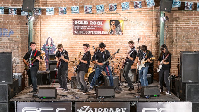 The Guitarnauts rock out at last year's Proof is in the Pudding.
