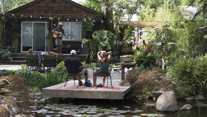 Chris Miles performs at Sierra Water Gardens. Dickerson Road is lined with art studios, commercial, residential and nature preserves. Discover Dickerson showcased these establishments while artists gave presentations and tutorials and musicans played.