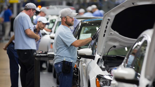 Workers at the Volkswagen plant in Chattanooga, Tenn., will decide Friday, Feb. 14, 2014, whether they want to be represented by the United Auto Workers union. The UAW says it has signatures of more than half of the plant workers on cards supporting representation.