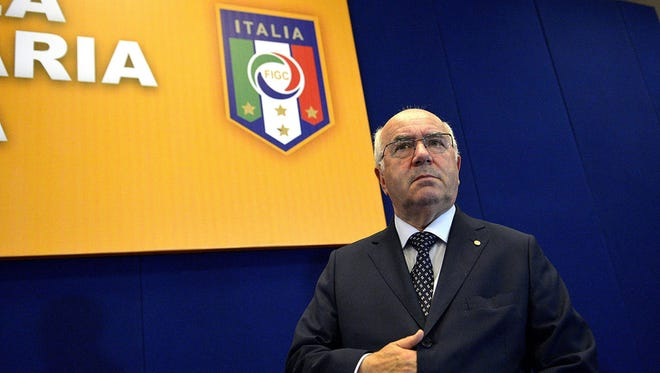 """Carlo Tavecchio attends an assembly of the National Amateur League in Rome. FIFA has asked the Italian football federation to open an investigation into alleged racist comments made by FIGC presidential candidate Carlo Tavecchio. """"Media reports concerning alleged racist comments by one of the presidential candidates for the Italian FA have alerted FIFA's Task Force against racism and discrimination and its chairman Jeffrey Webb."""