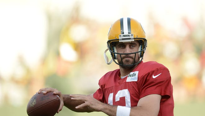 Green Bay Packers quarterback Aaron Rodgers runs drills during training camp practice at Ray Nitschke Field on Monday, Aug. 4, 2014. Evan Siegle/Press-Gazette Media