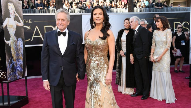 Michael Douglas and Catherine Zeta-Jones  arrives at the Academy Awards. The couple is selling their Bedford, NY home.