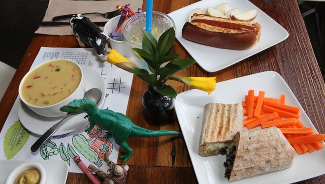 Items including a burrito made with rice, beans and cheese and carrot sticks, a hot dog and West African coconut curry organic soup from the kids menu at the Local cafe in Chappaqua.