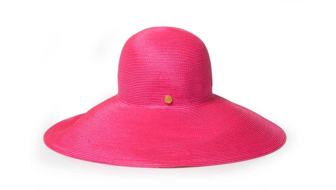 Protect your head and make a fashion statement in this Eric Javits packable wide-brim hat of synthetic straw.