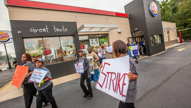 Protesters leave the building after presenting the Burger King management with a strike notice in August.