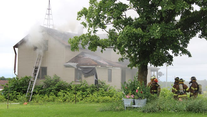 Firefighters respond to a house fire Wednesday morning in Colby.