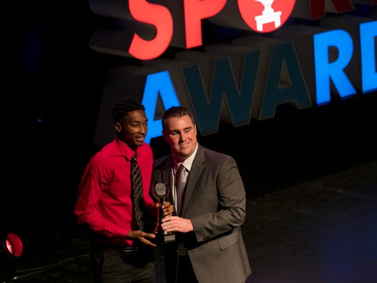 Berrick Jeanlouis accepts his award for Basketball Player of the Year at the Southwest Florida Sports Awards on Wednesday, May 23, 2018, at Barbara B. Mann Performing Arts Hall in Fort Myers.