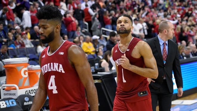 Indiana guard James Blackmon Jr. (1) and guard Robert Johnson (4) walk off the court after Wisconsin defeated Indiana 70-60 in the Big Ten tournament Friday, in Washington.