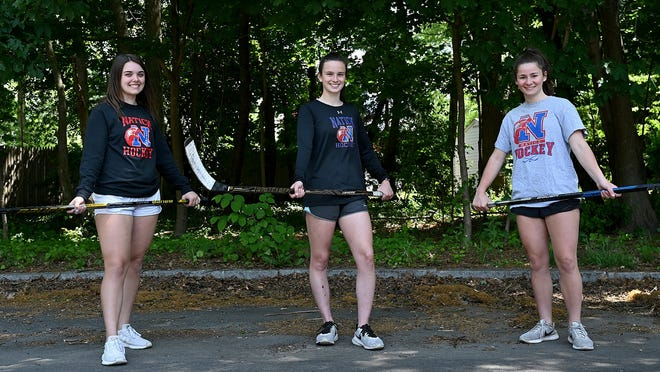 Natick hockey captains Nicole Schnair, left, Erin Quirk and Jacqui Poulack.