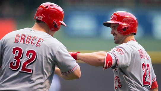 Reds left fielder Adam Duvall (right) celebrates with