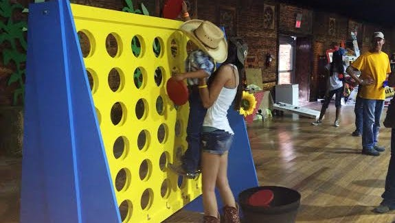 A life-size game of Connect Four was part of the kid-friendly entertainment in the Half-Pint Hootenanny tent.