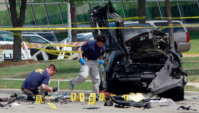 FBI investigators work a crime scene outside of the Curtis Culwell Center. Police shot and killed the men after they opened fire on a security officer outside the suburban Dallas venue, which was hosting a contest for Prophet Muhammad cartoons.