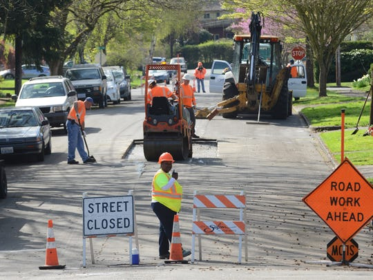 A portion of Cottage Street SE between Electric and Hoyt is closed as a City of Salem crew repairs a stretch of the road on Friday in Salem.