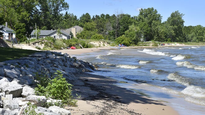 Significant erosion of the waterfront of at least 20 feet in Jacksonport of side-by-side land owners with rip rap protection at left versus neighbors without protection on Lake Michigan in the past few years.