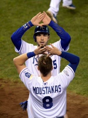 Eric Hosmer  and Mike Moustakas celebrate after scoring in the second inning.