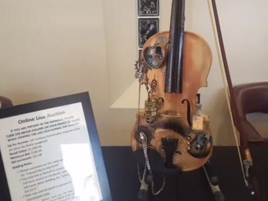 The 19th Century Industrialist inspired violin art piece by Sheila Lougheed, which sold for $250 in the auction.