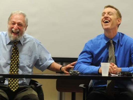 Dr. Frank Ochberg, psychiatrist and trauma specialist, and author Dave Cullen share a lighthearted moment during a trauma journalism seminar July 30 at the Pennsylvania Newsmedia Association. (Jason Plotkin/York Daily Record)
