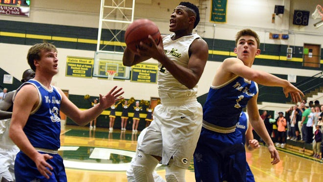 Gallatin High junior Zyun Mason elevates for an interior shot during first-quarter action against White House on Tuesday. Mason scored 12 points in the Green Wave's 68-46 victory.