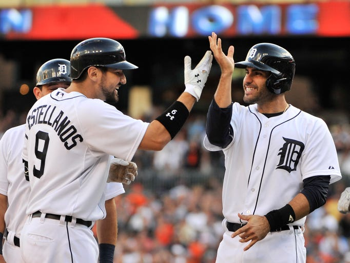 Tigers' J.D. Martinez, right, congratulates Nick Castellanos,