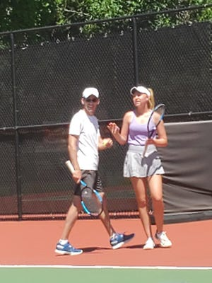 Manhattan tennis star Jill Harkin and her father, Kenneth, competed in the parent-child division of the Sunflower State Games tennis competition this past weekend at Kossover Tennis Center.