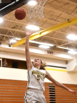 Watkins Memorial sophomore Taylor Looney shoots a layup during a February game.