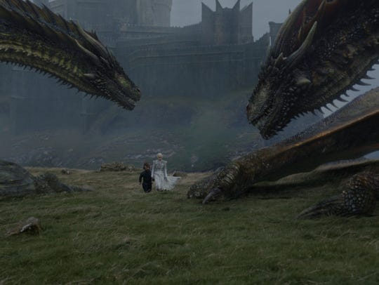 Daenerys and Tyrion take two of the dragons for walkies.